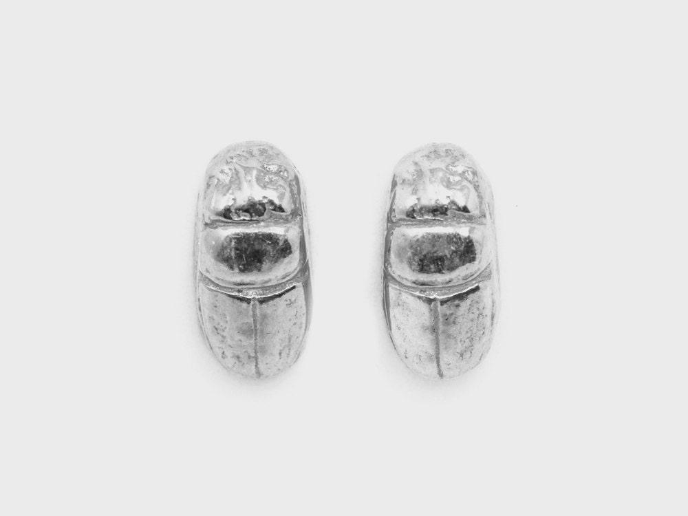 A pair of silver scarab beetle stud earrings from Omi Woods