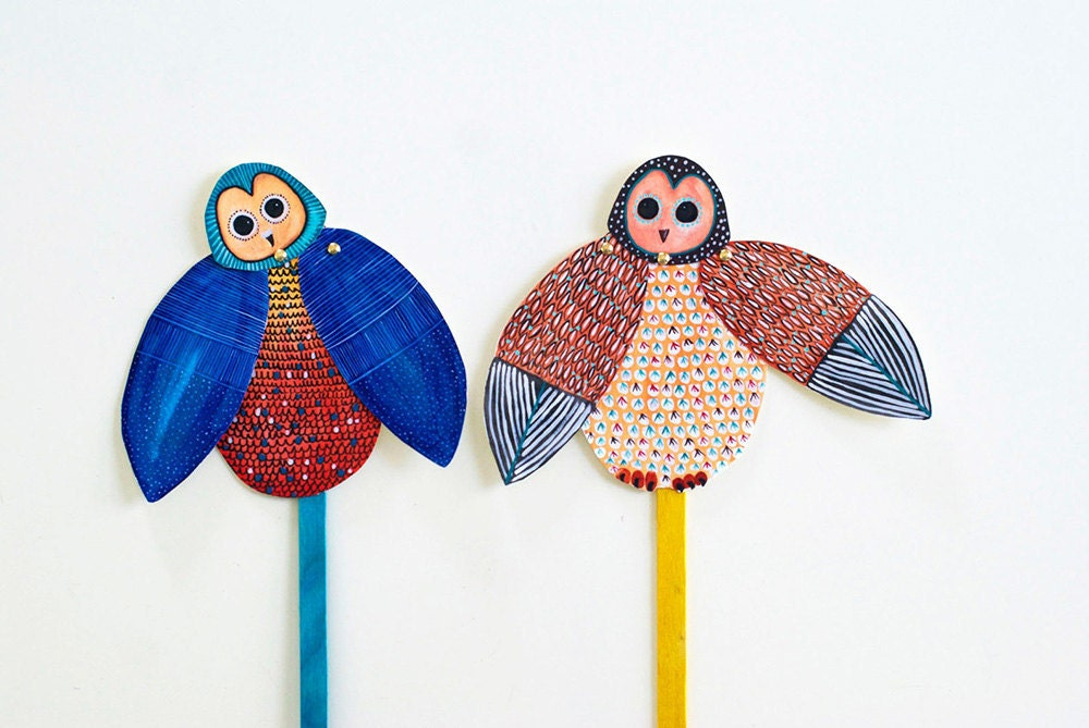 Two owl puppets with moving wings made of paper