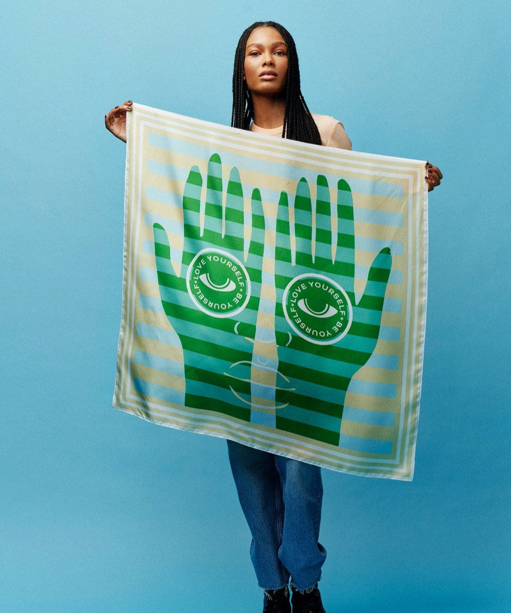 """A """"Be Yourself, Love Yourself"""" scarf from the Honey Dijon Creator Collab, designed by All Very Goods"""