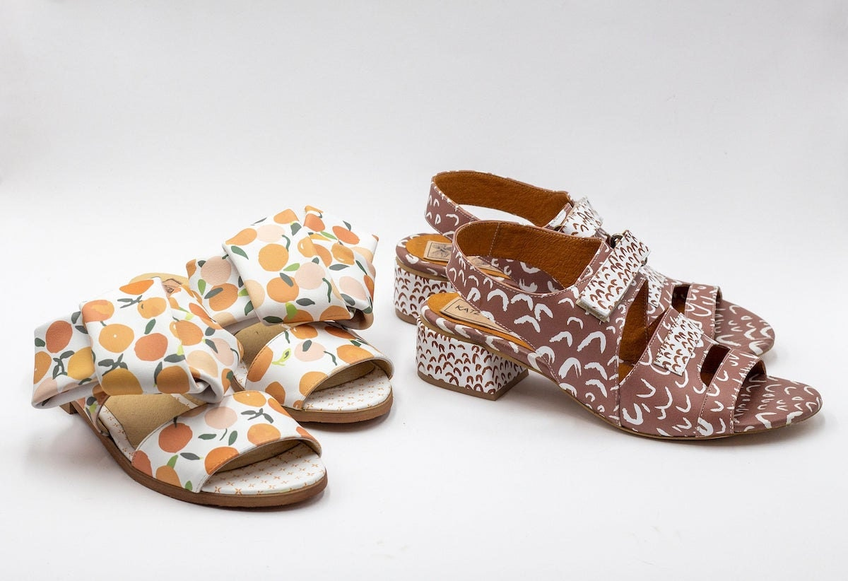 Orange print slip-on leather sandals and slingback brown printed leather sandals both from Katz and Birds
