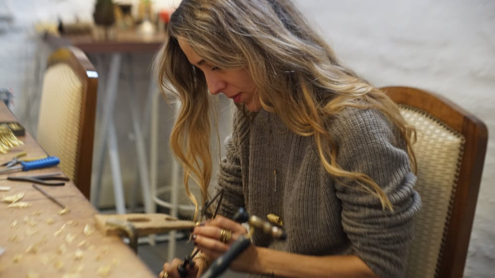 Maria working on jewelry in her Mexico City studio