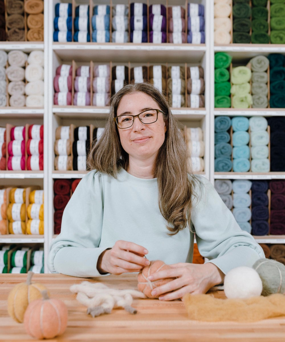 A portrait of needle felting kit seller Elizabeth Whitton in her Michigan studio.
