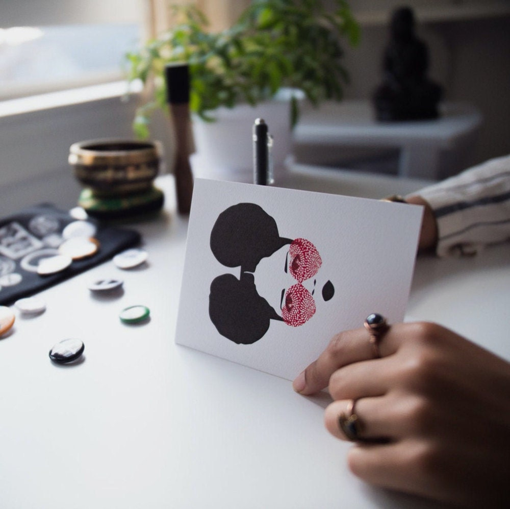 Ama writes in one of her greeting card designs.