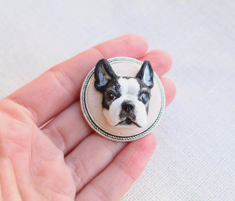 A hand-sculpted clay brooch customized to look like a dog's face, from Nico Made Me