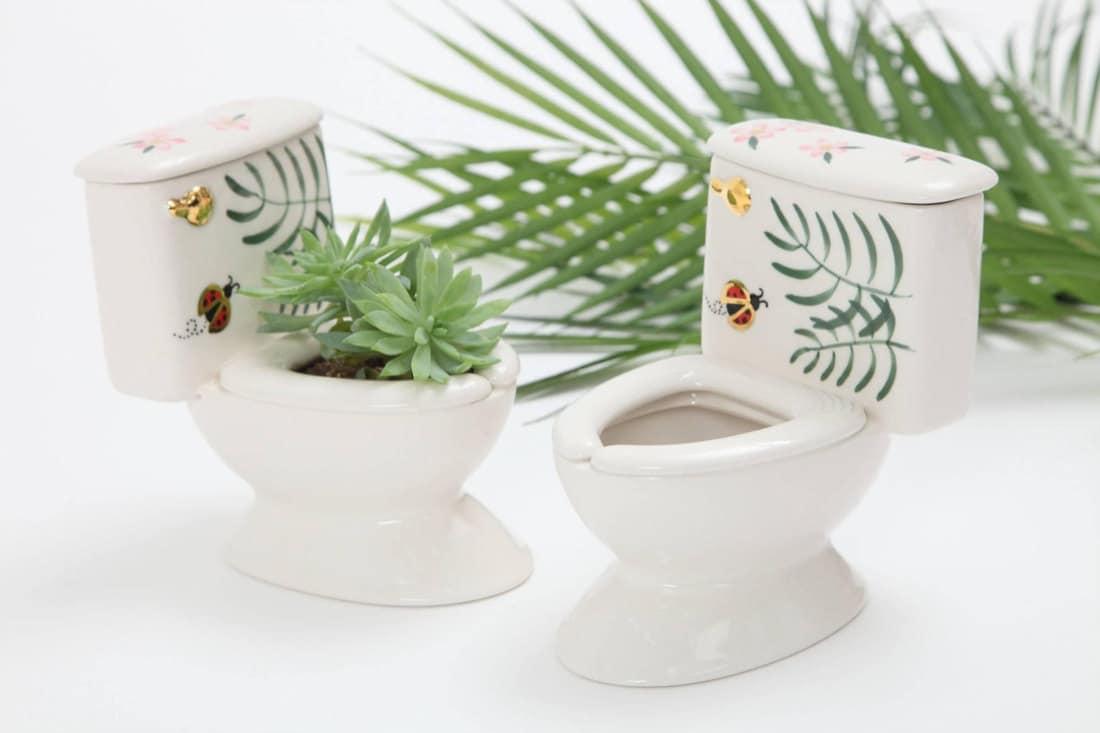 A set of two miniature porcelain toilet planters from MsPotterCeramics
