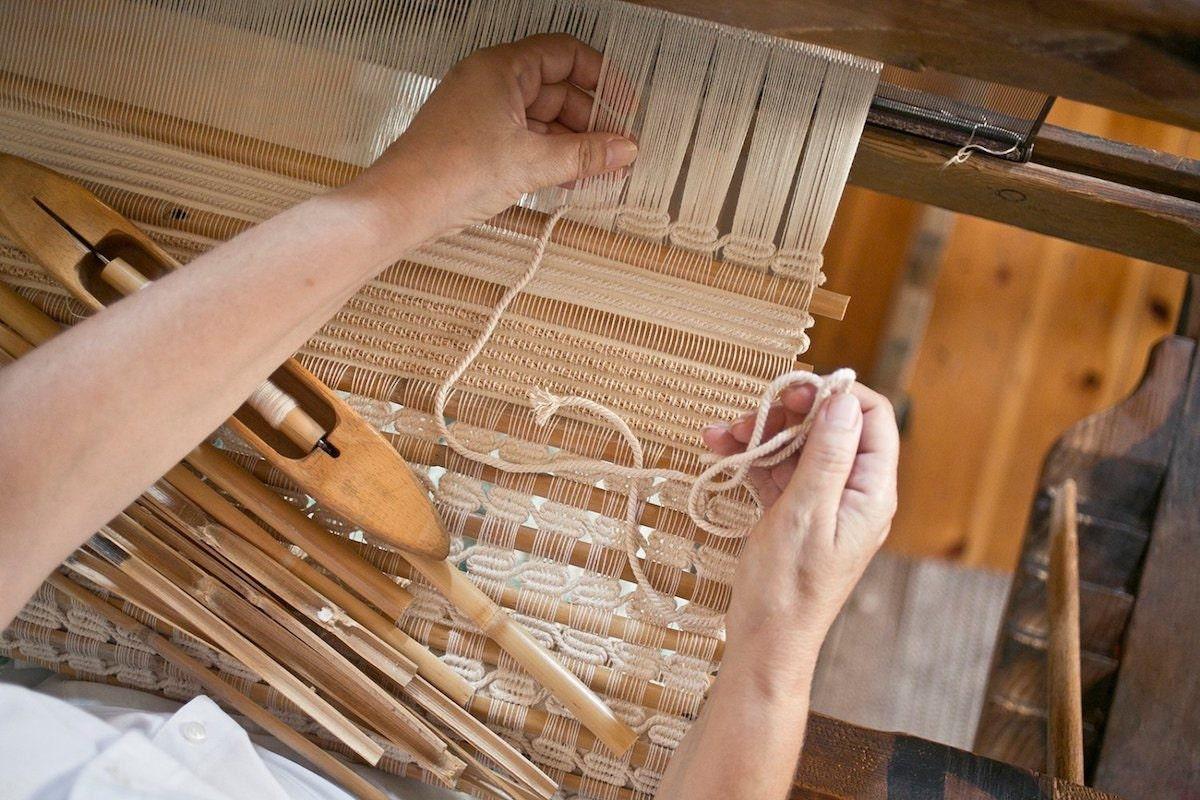 A closeup of the weaving process