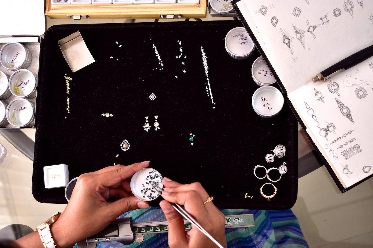 Madhulika Anchalia sorts through loose stones at her workbench