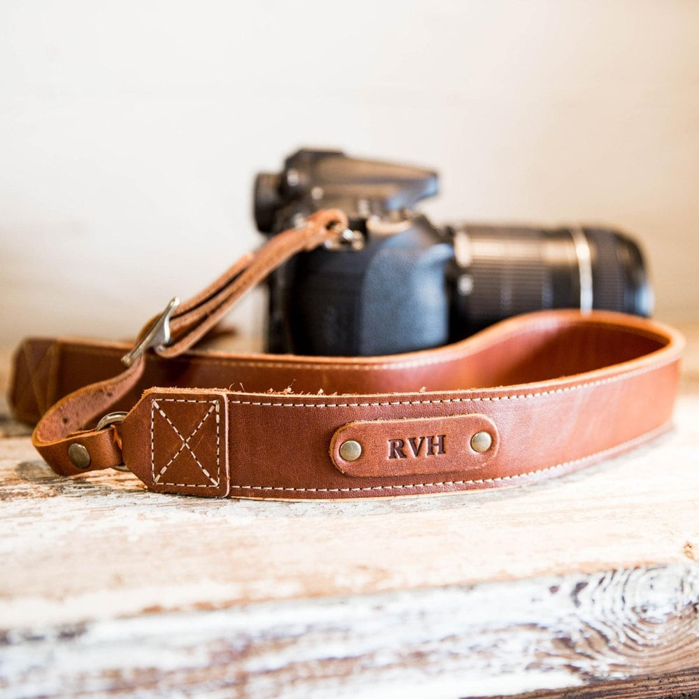 A personalized leather camera strap from Holtz Leather Co.