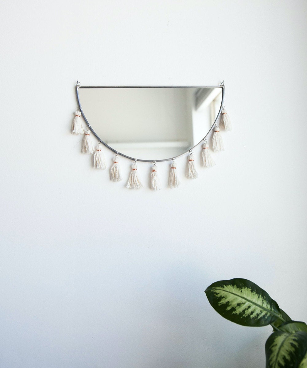 A half-moon tassel mirror from Szklo Glass