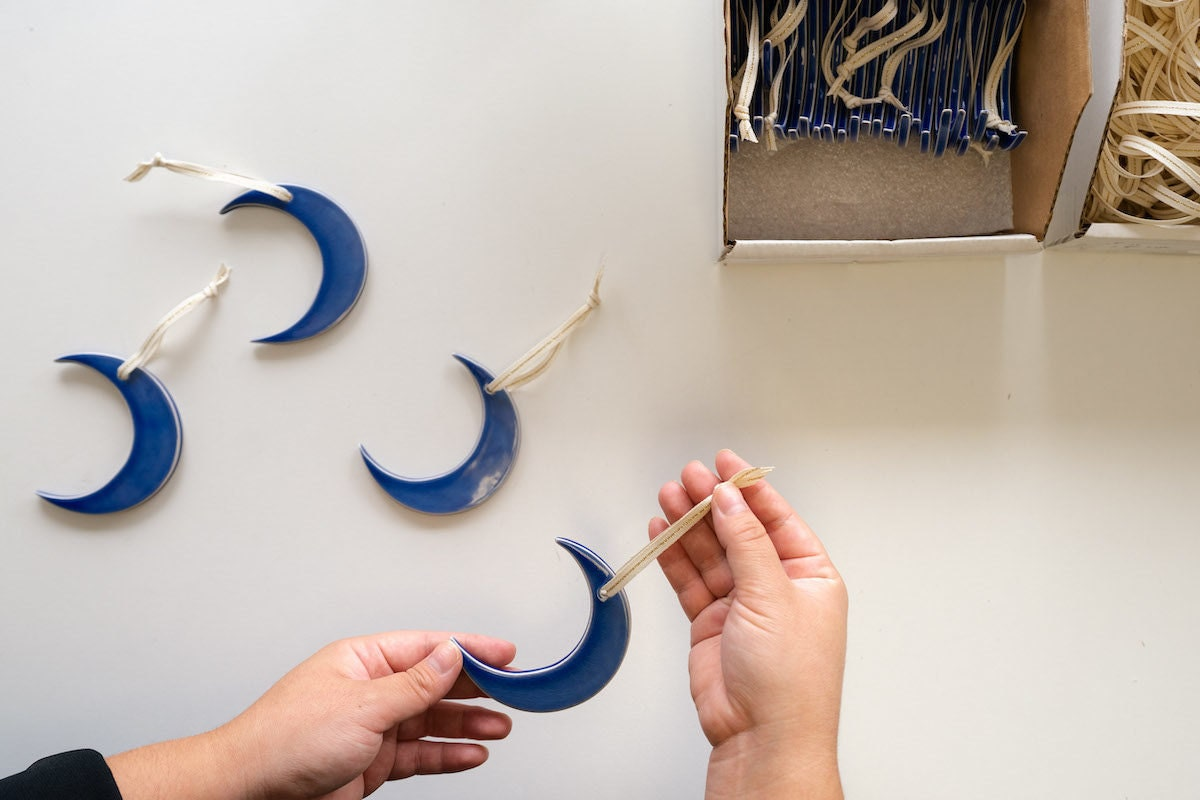 Ceramic crescent moon ornament from Hereafter