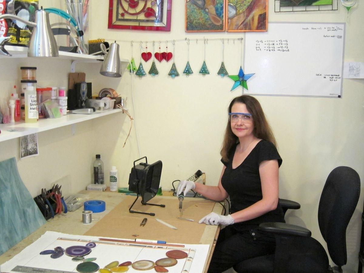 Alla at her desk in her studio