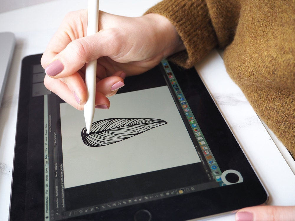Mica sketches a leaf for an earring design.