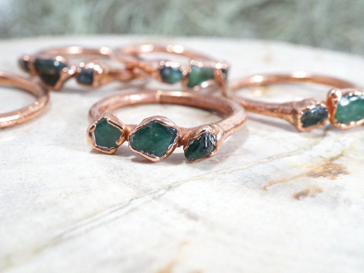 Raw emerald gemstone rings from Pebble & Stone
