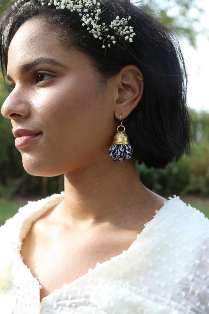 Gold-plated pom-pom earrings from Lingua Nigra