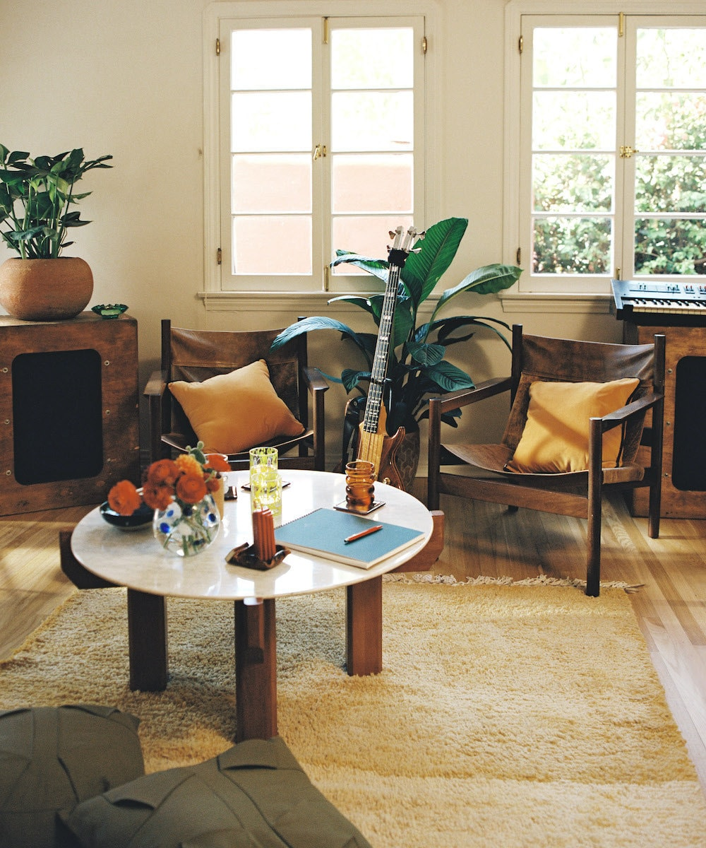 HAIM's home studio styled with a vintage Moroccan rug from Ounizz, from Etsy