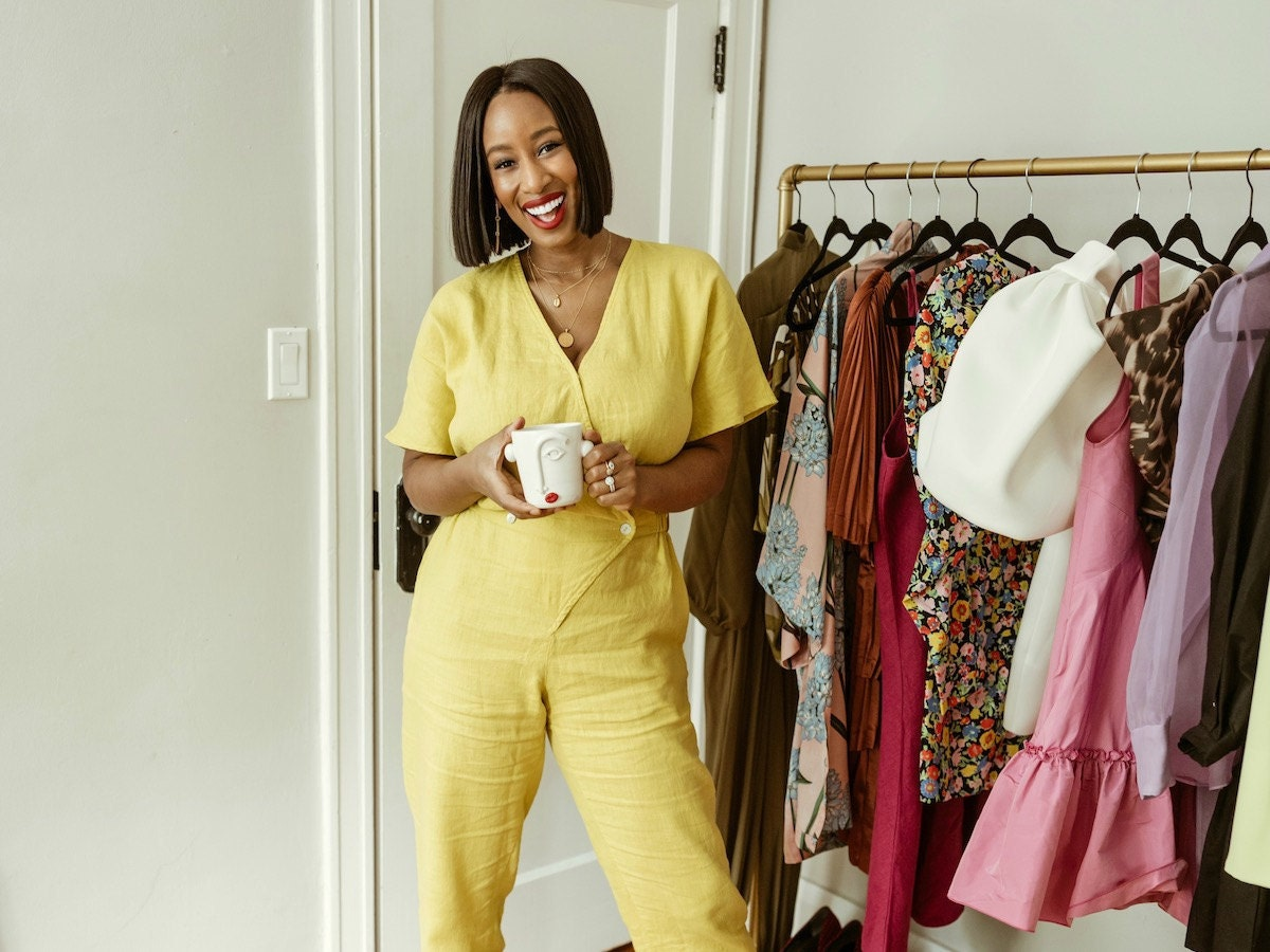 Shay wearing a linen yellow jumpsuit