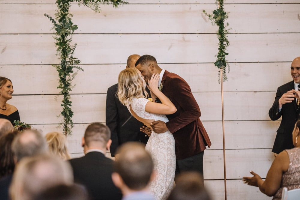 Emily and Terrell have their first kiss as husband and wife