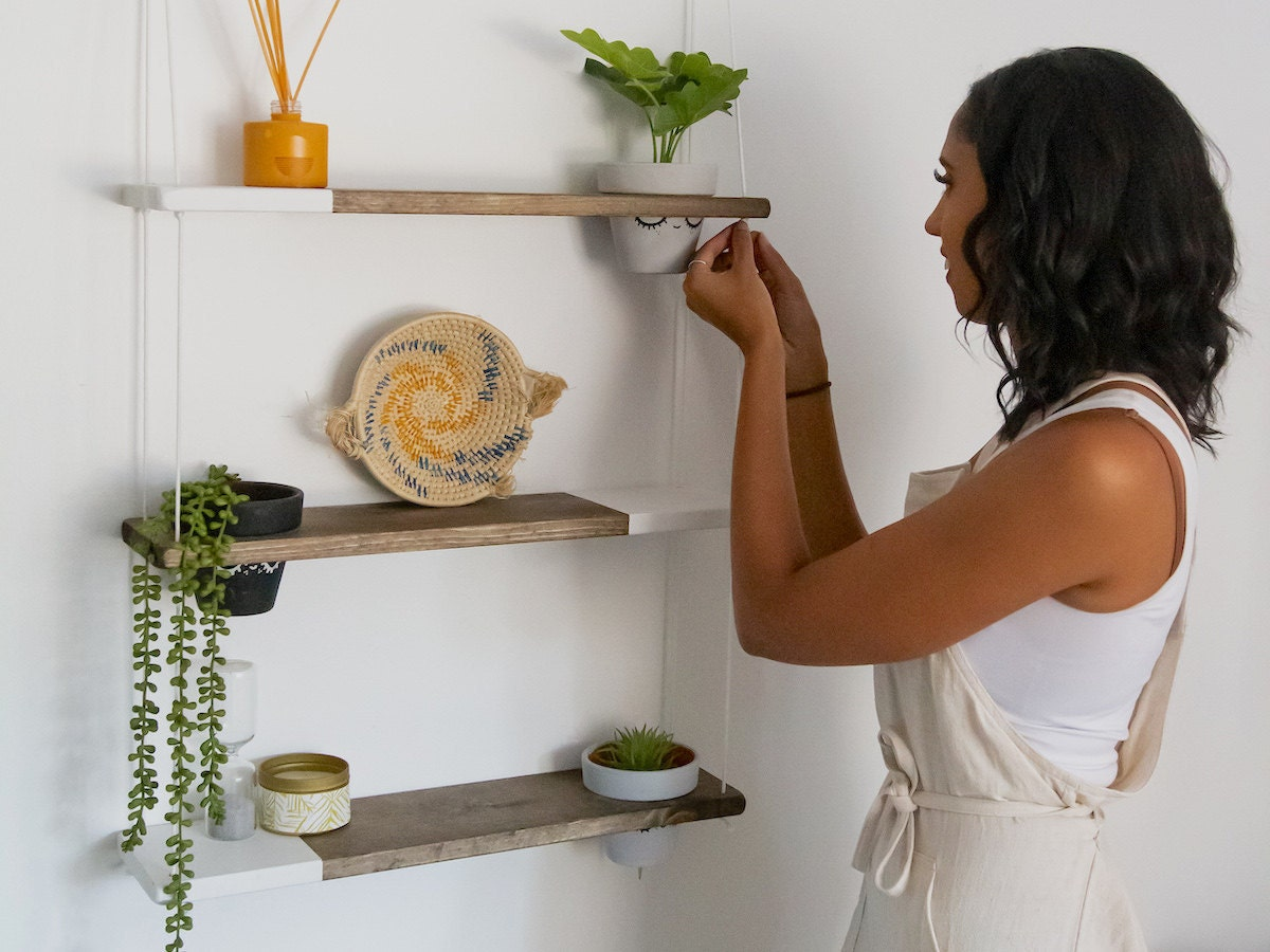 TheCraftySwirl shop owner Ilana Mayes styles one of her signature two-tone shelves.