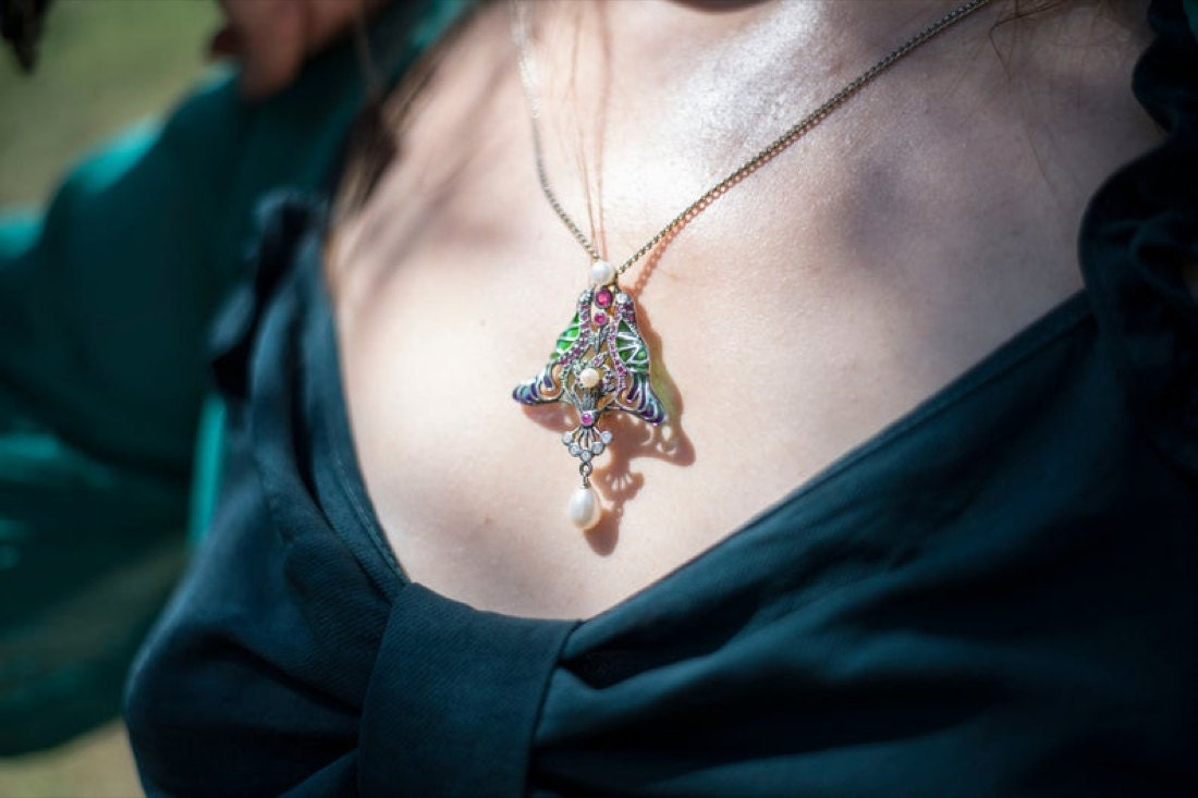 A ruby, diamond, and pearl pendant from KK Vintage Collection