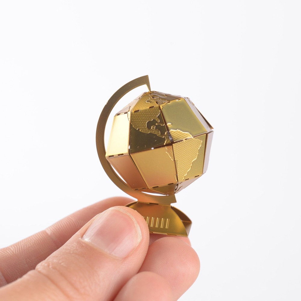 A miniature brass globe model kit from Another Studio.