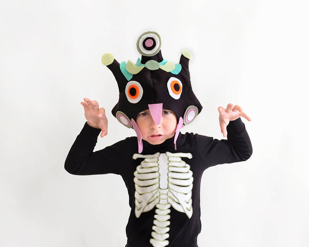 A child makes his best scary face while wearing a hand-sewn monster mask created from a pattern by ImaginaryTail.