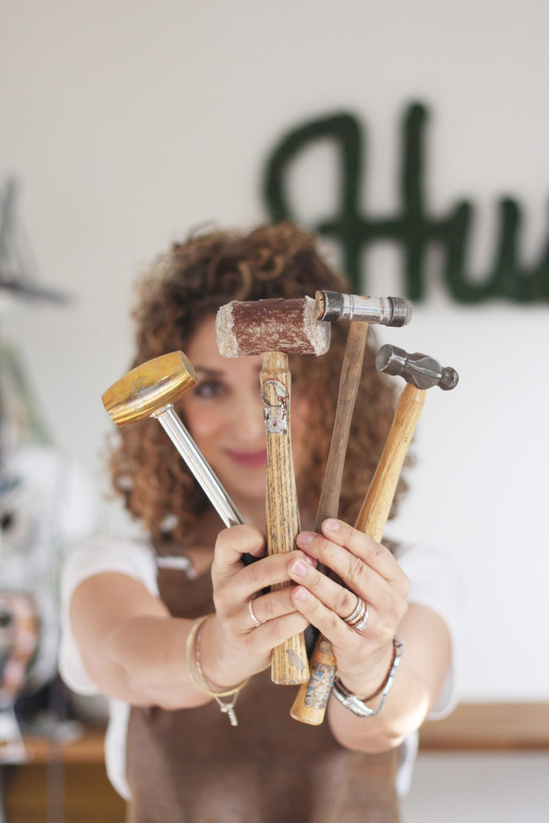 Ghazal holds a handful of her jewelry-making tools