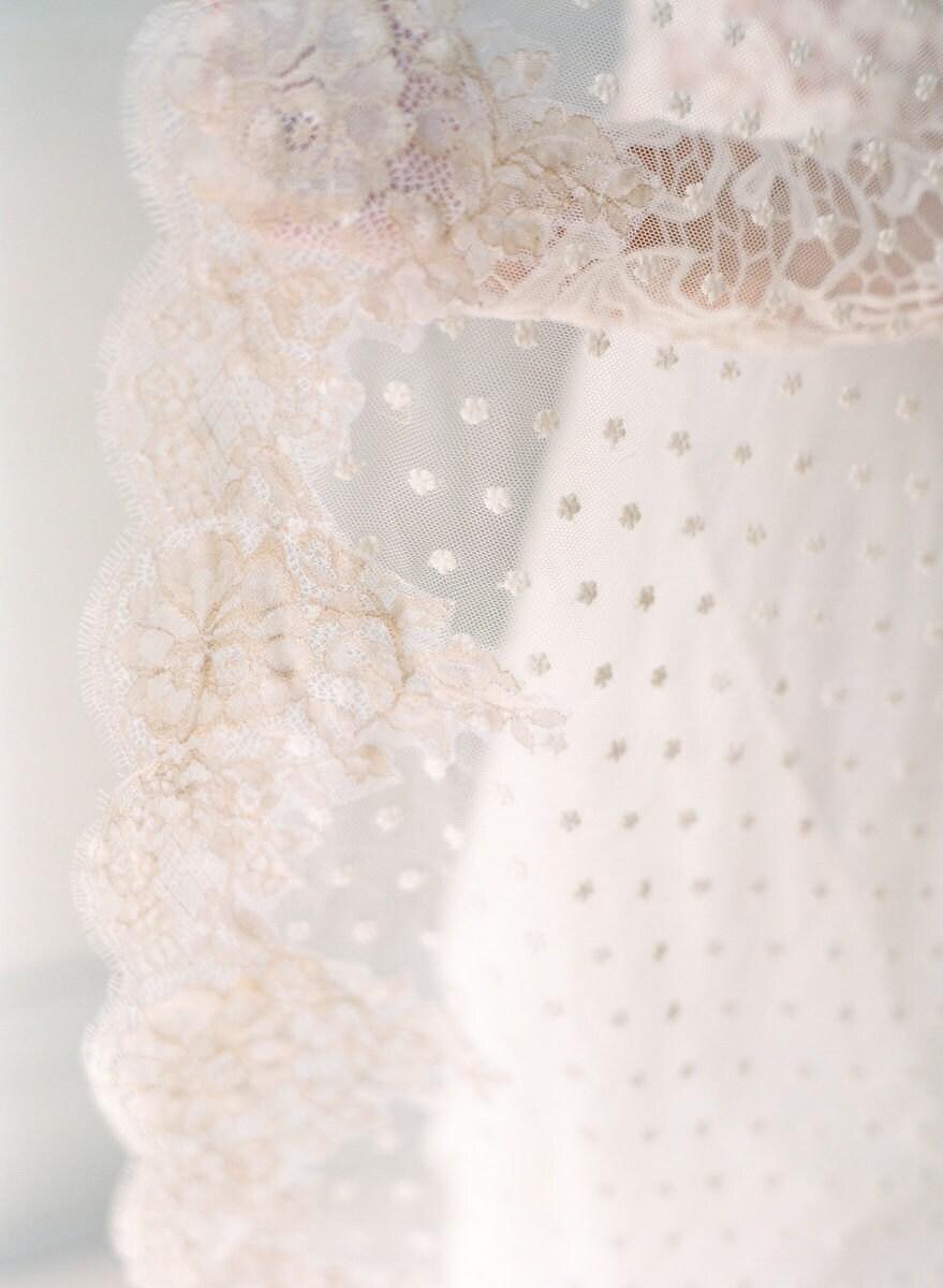 Details on a dotted mantilla veil