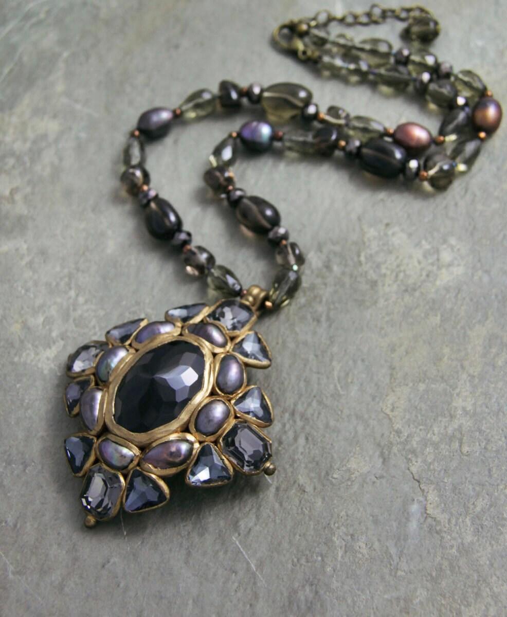 Smoky quartz cross pendant; $145