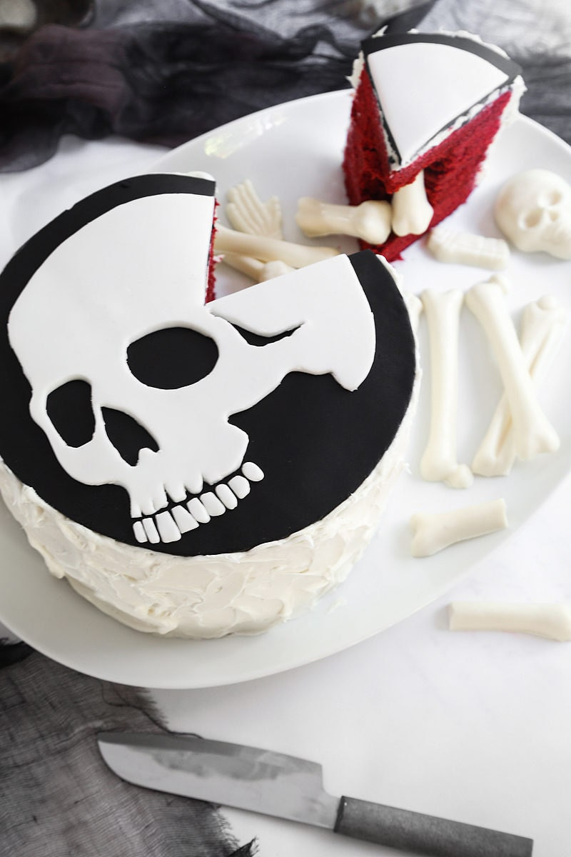 A homemade red velvet skeleton cake