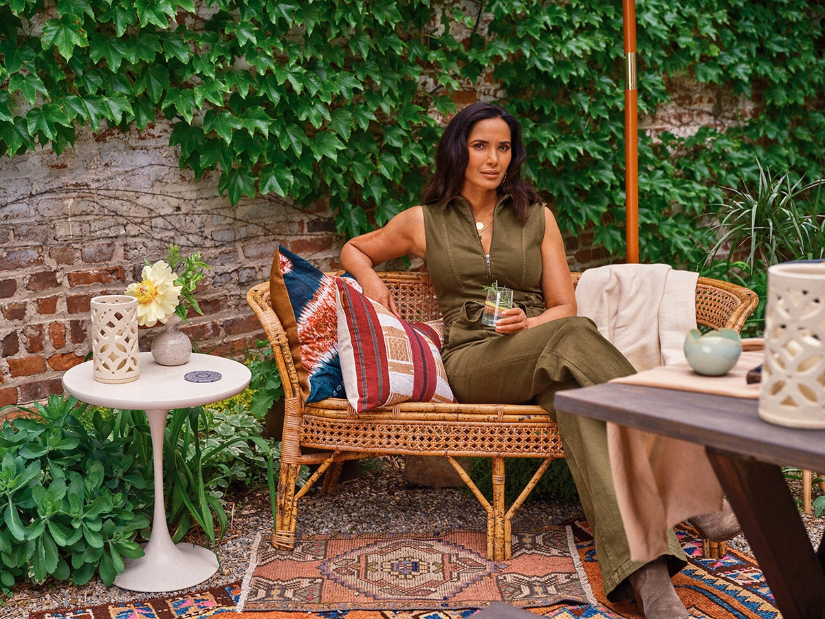 Padma Lakshmi sits outside