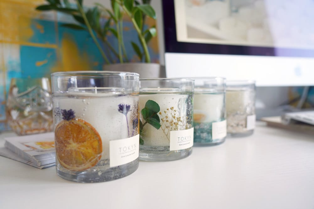 A row of candles from Rino's botanical collection lined up on her desk