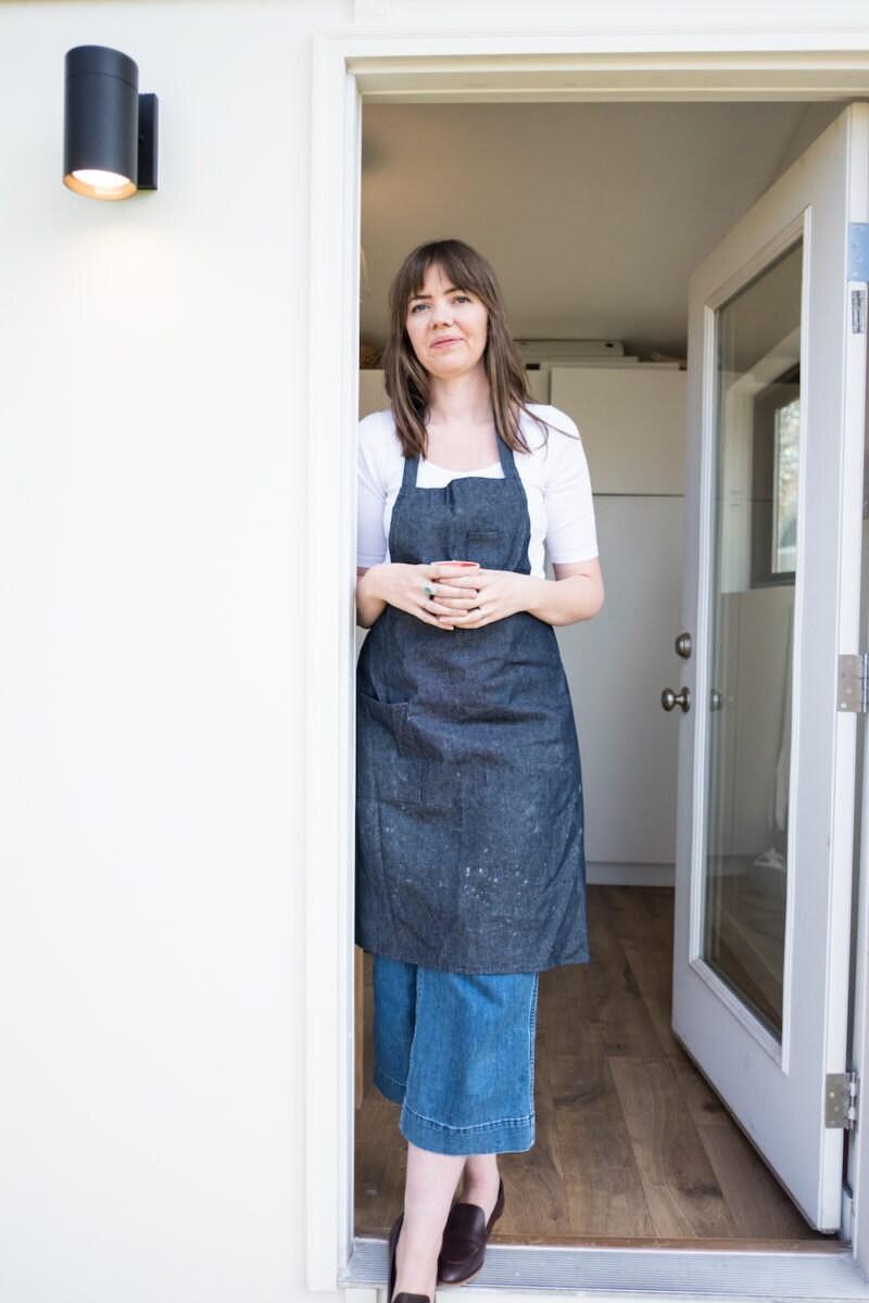 Sarah posing in her studio door