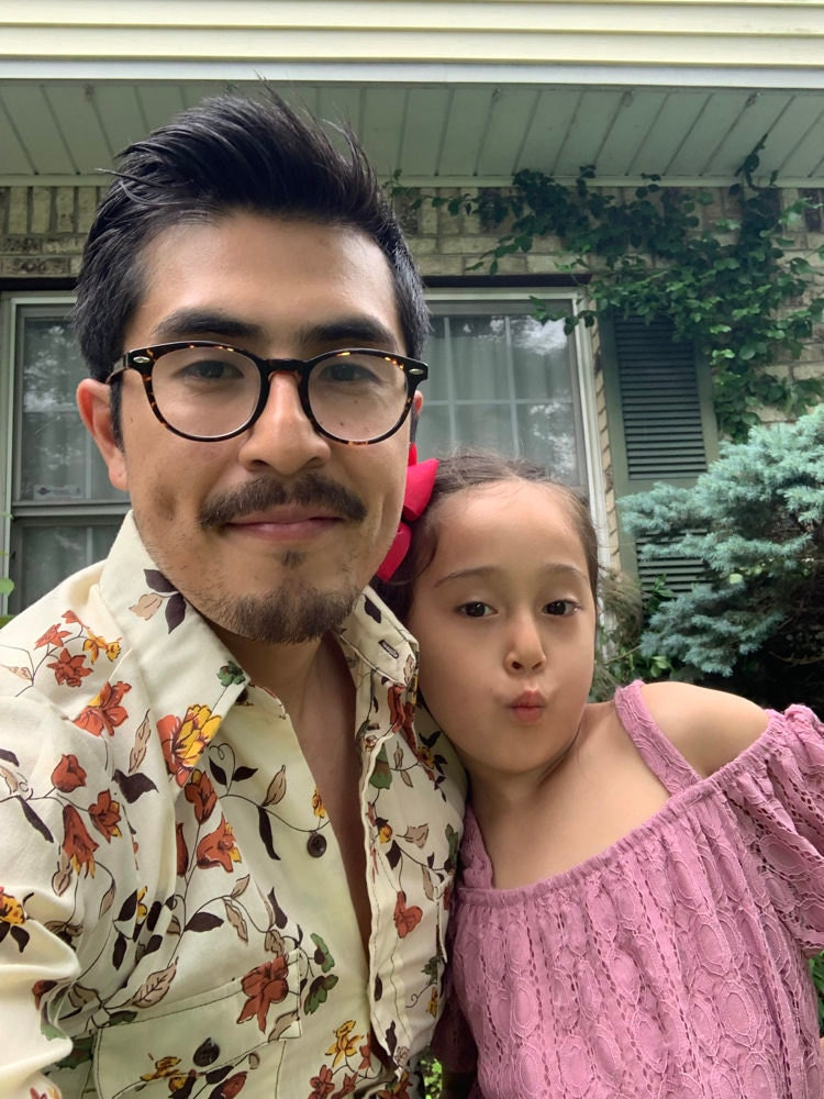 A portrait of Etsy Senior Account Security Agent Ramon Gutierrez and his daughter.