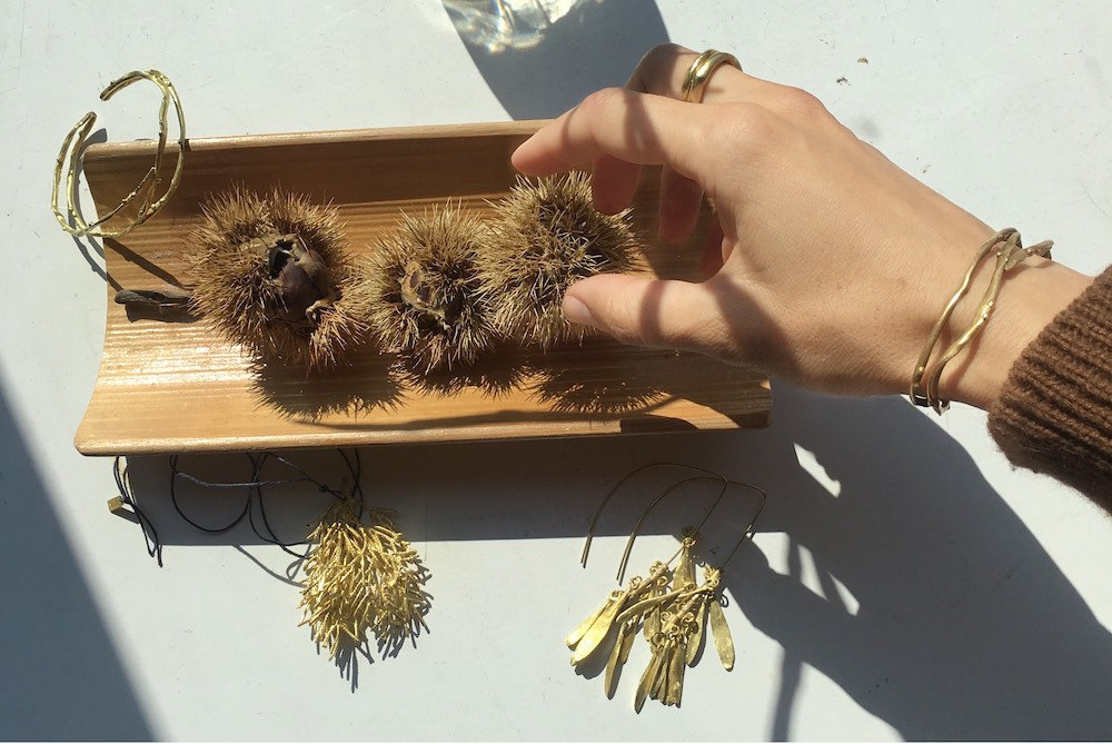 Maria arranges some of her inspirational finds from nature alongside a few of her finished pieces.