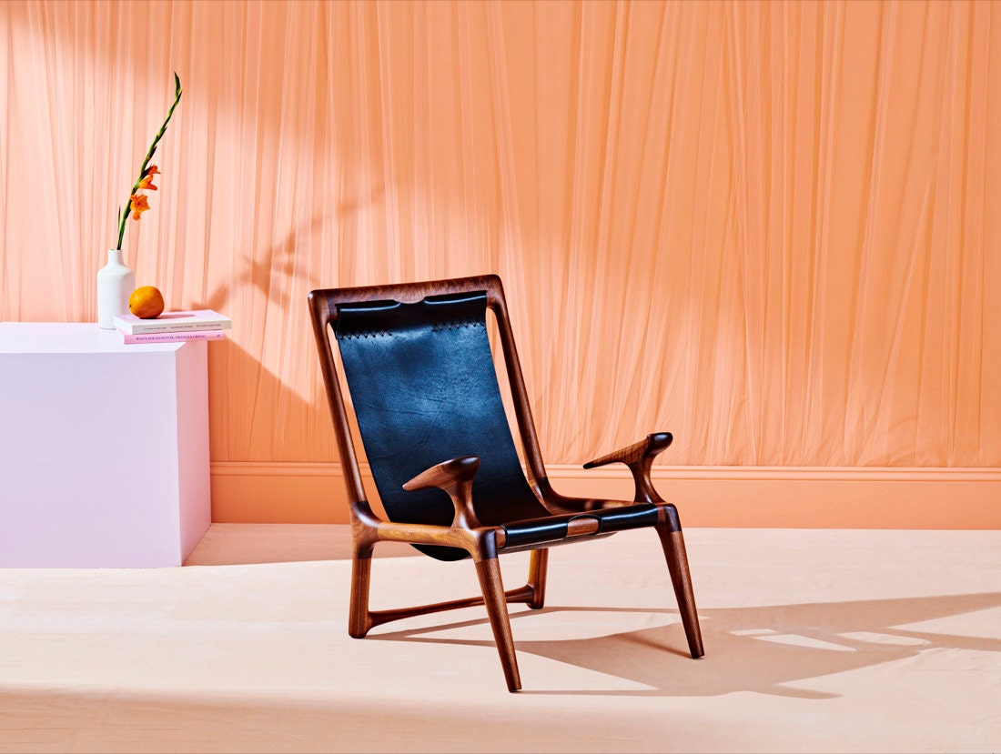 A walnut and leather sling chair from Fernweh Woodworking, winner of the Inventive Decor category.