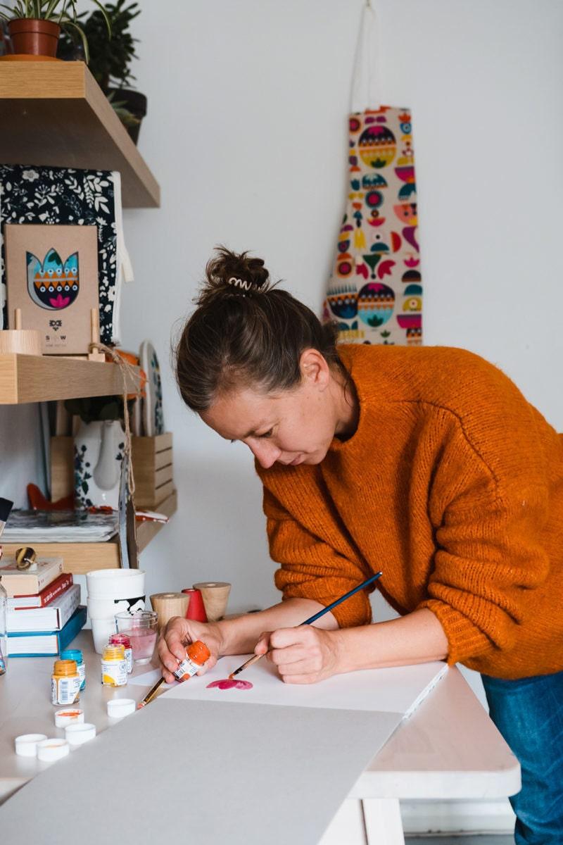Tatiana painting at her work bench