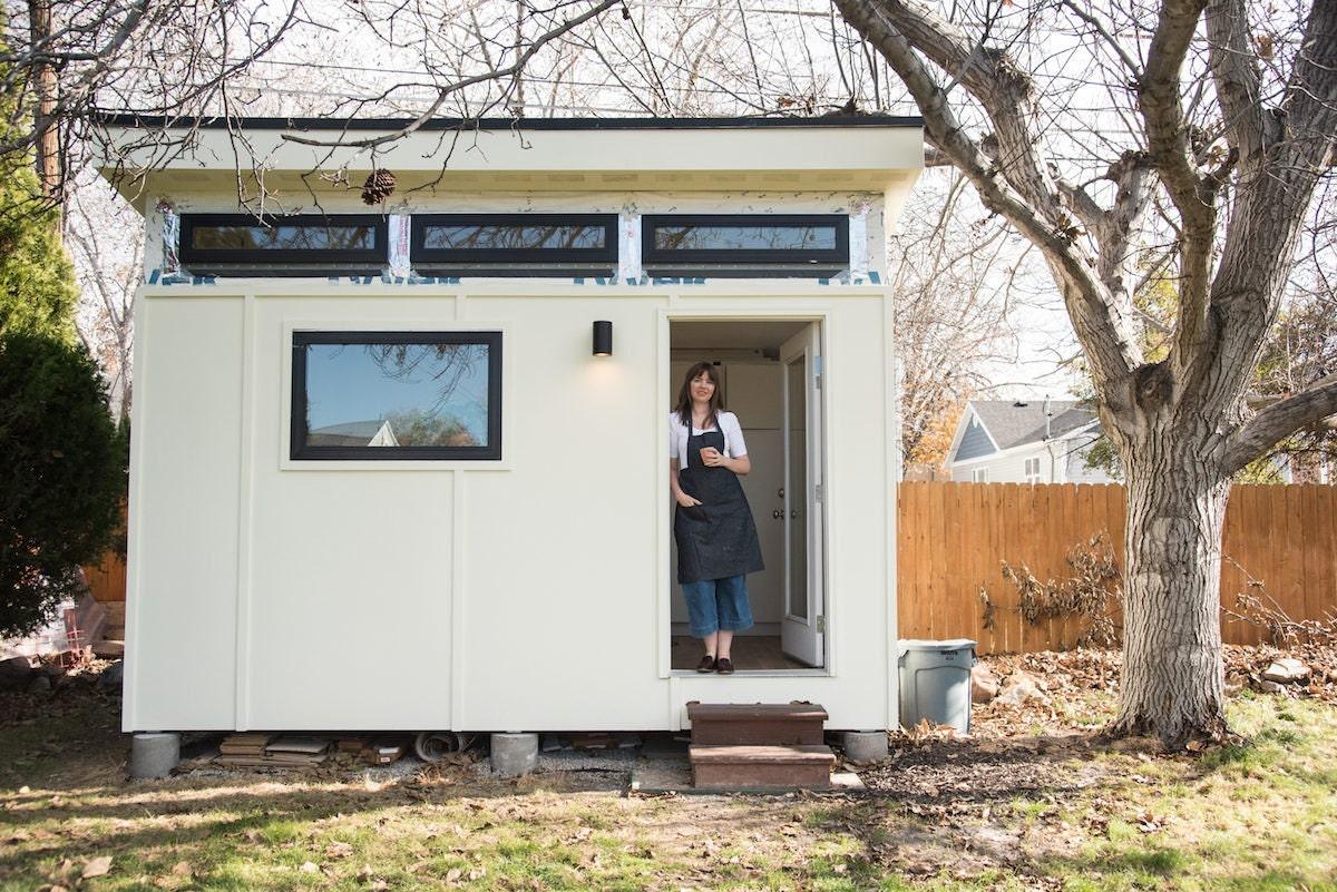 Sarah standing in the doorway of her backyard studio shed