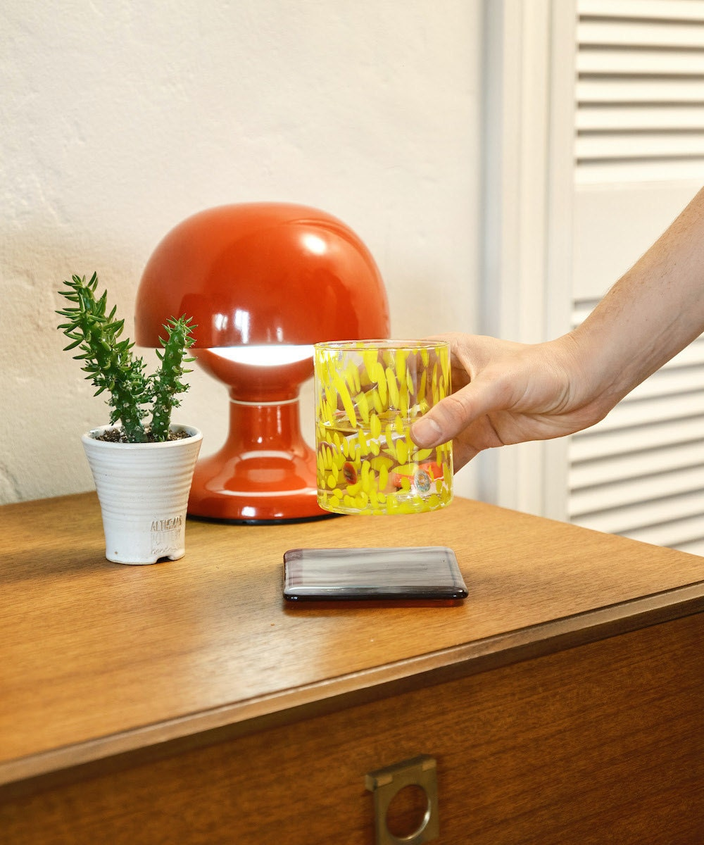 A vintage red mid-century lamp from Seconda Giovinezza on Etsy, styled on a desk.