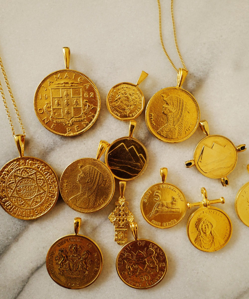 Assorted African gold coin pendants from Omi Woods