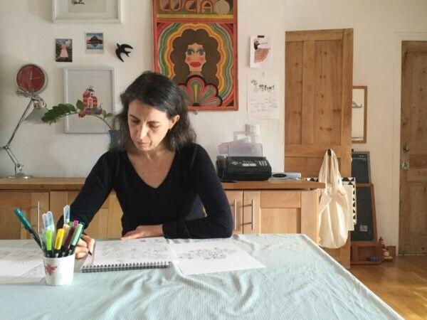 Yolande drawing in her studio
