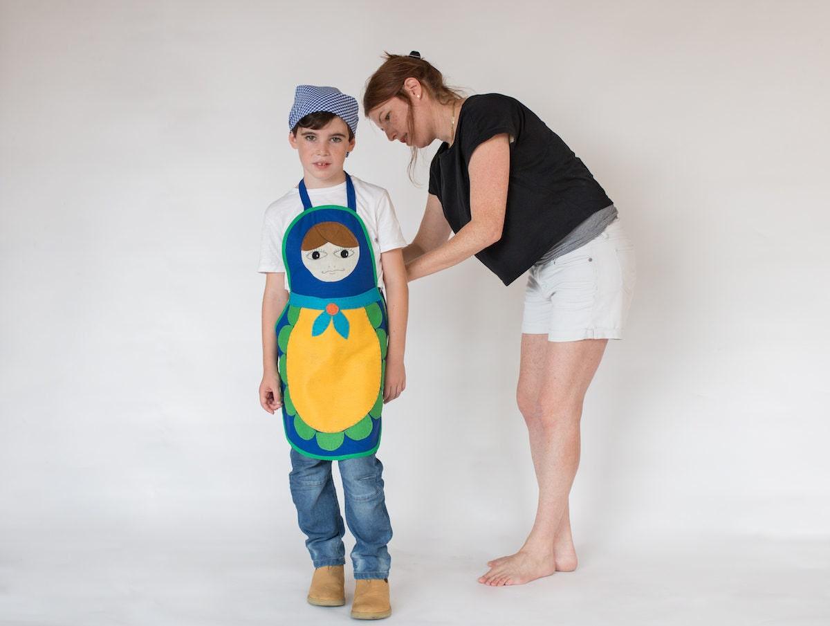 Inbal adjusting a costume on her son