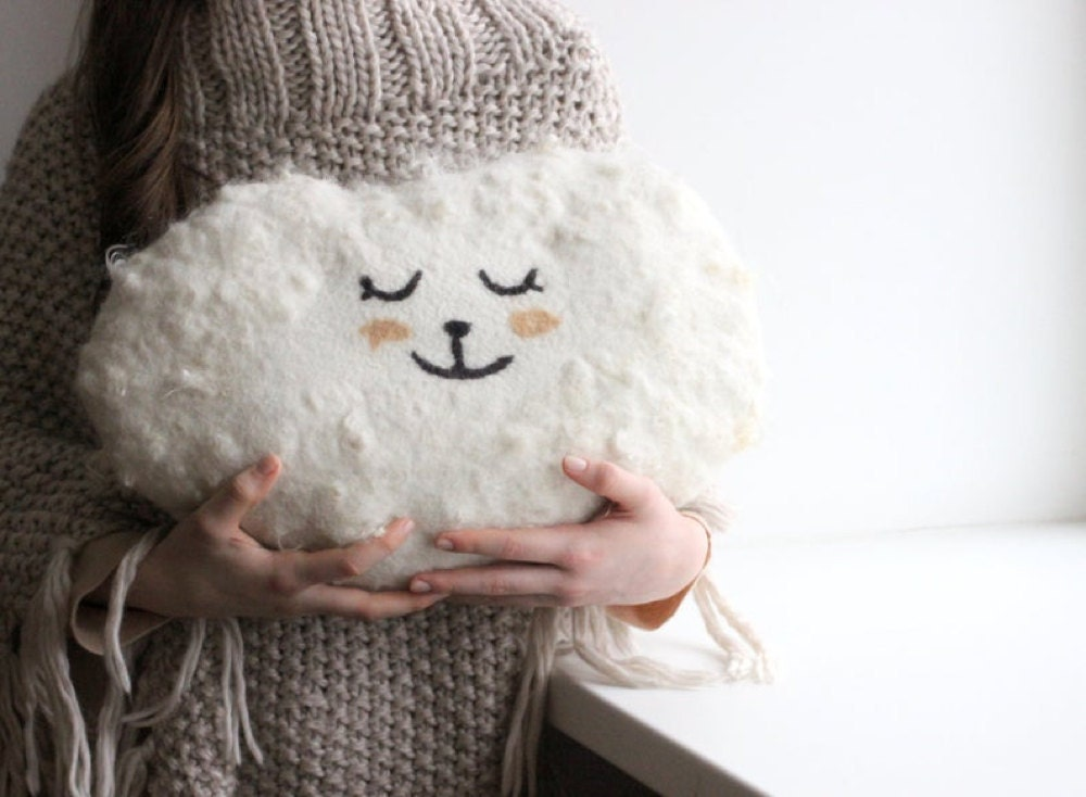 A cloud-shaped pillow made from felted wool from Agnes Felt