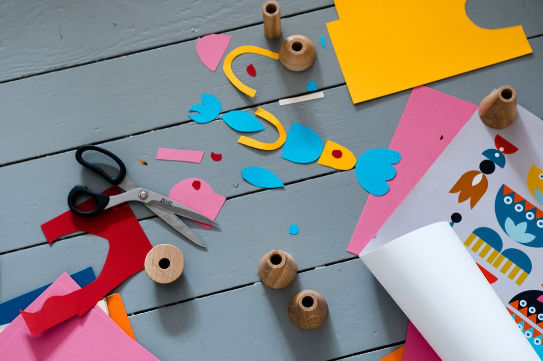 A pile of colorful cutout shapes arranged into beginnings of a surface pattern