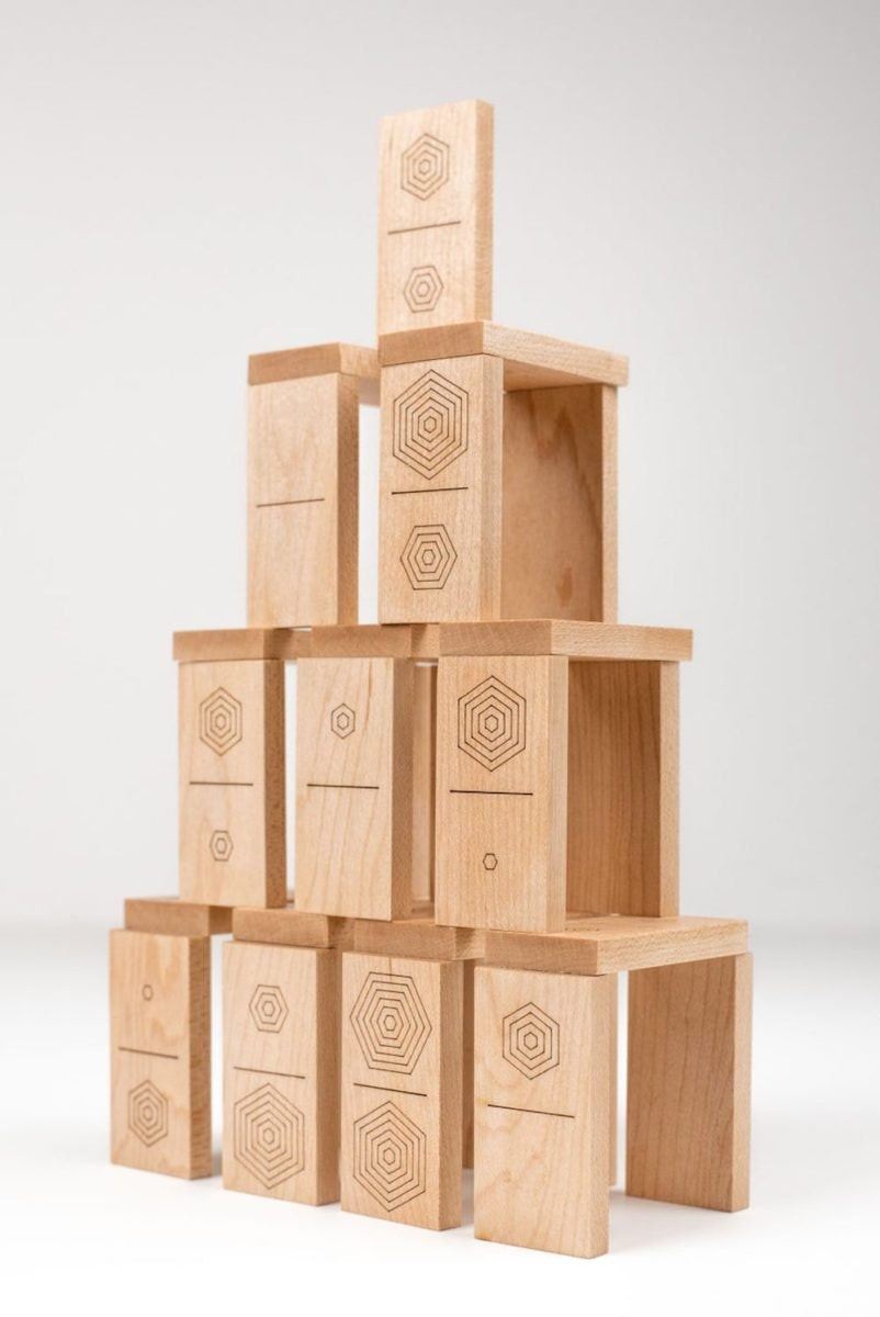 A laser-cut wooden domino set from Atelier-D