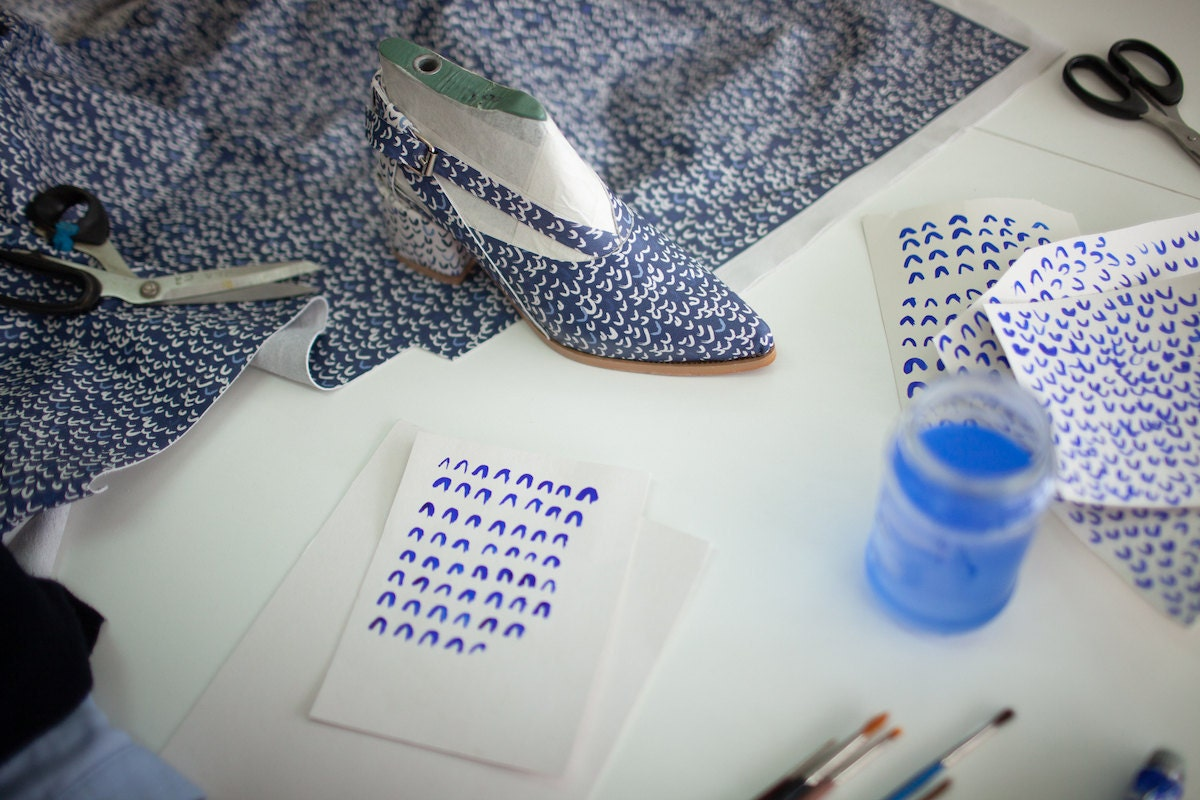 A pair of printed sandals-in-progress