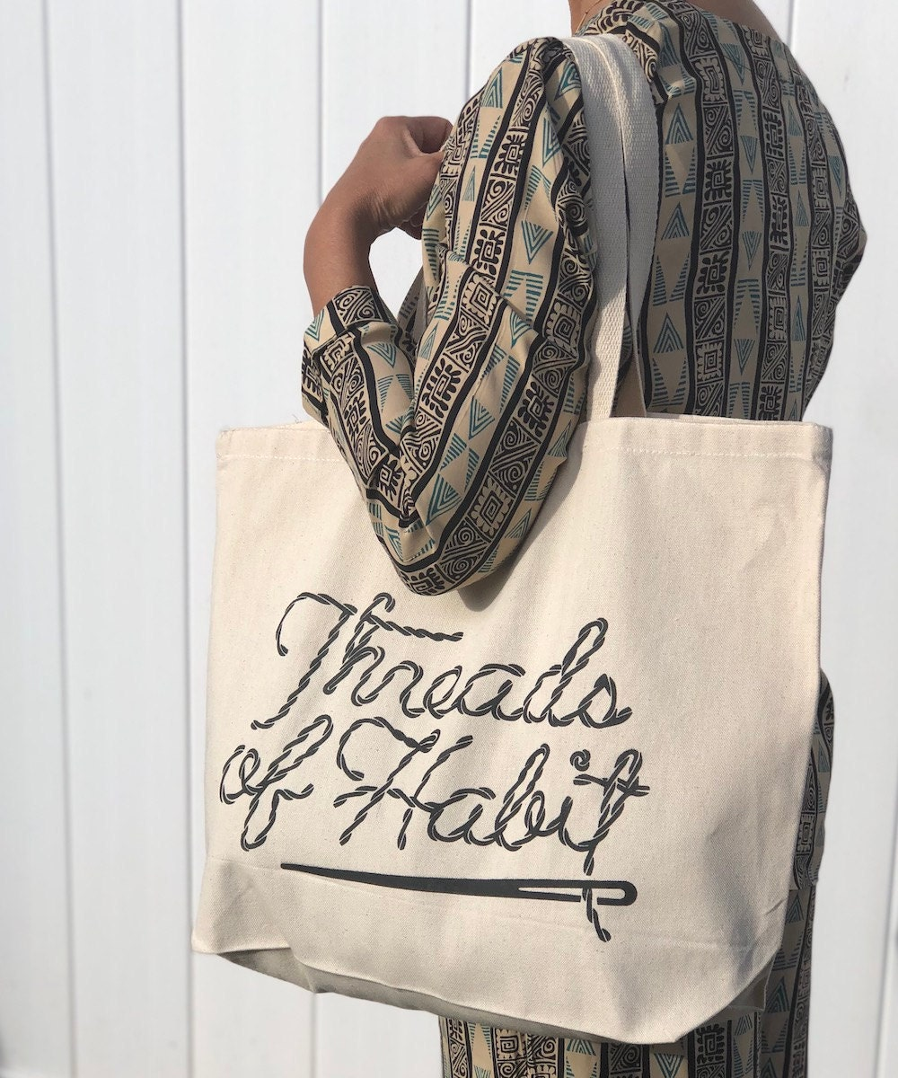 A Threads of Habit canvas tote