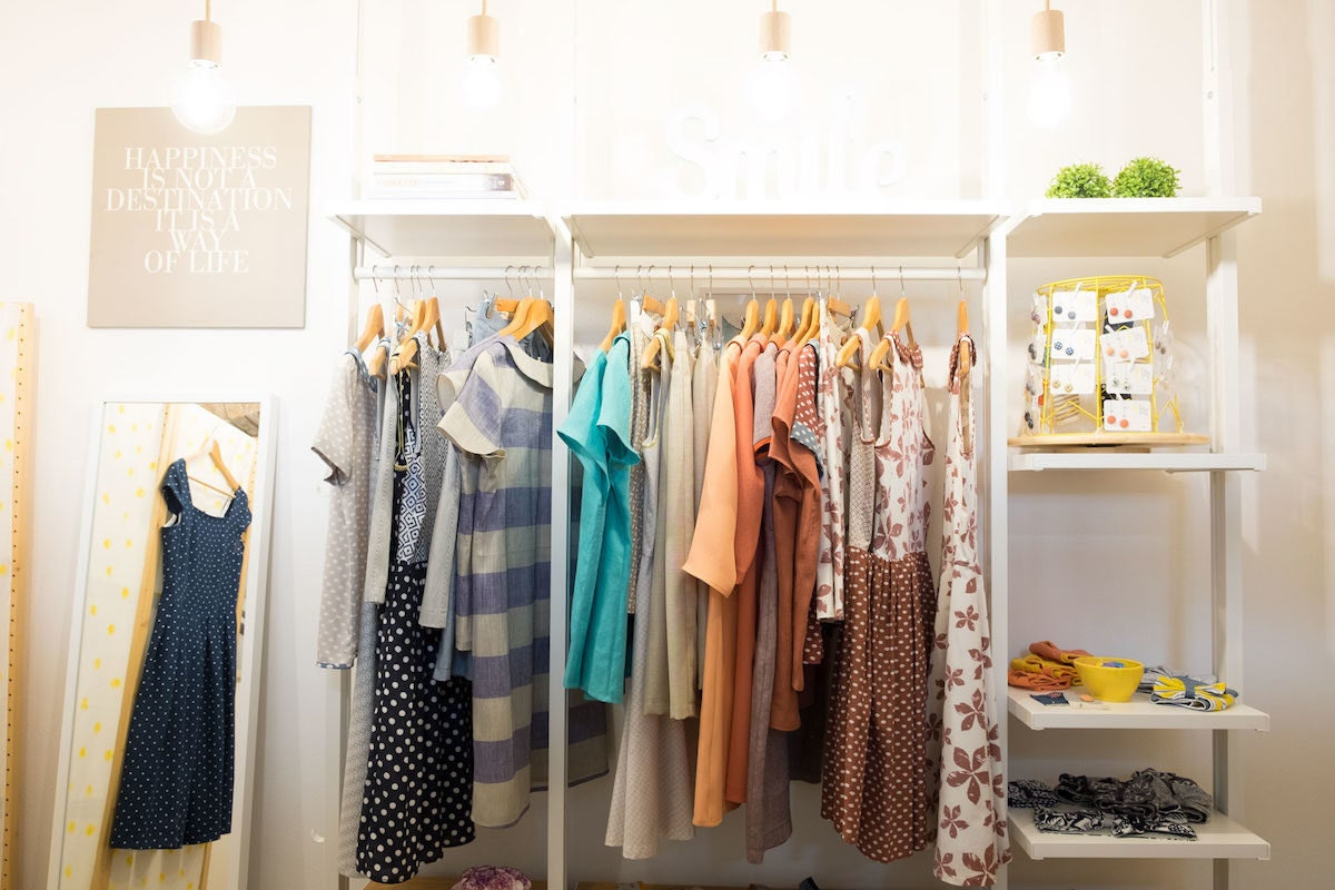 A rack of clothing and accessories from The Yellow Peg