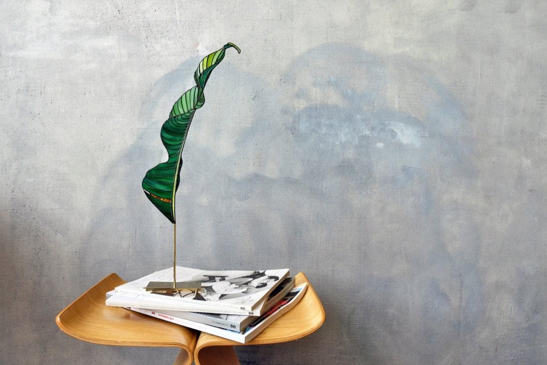 A stained-glass banana leaf suncatcher by Elena Zaycman