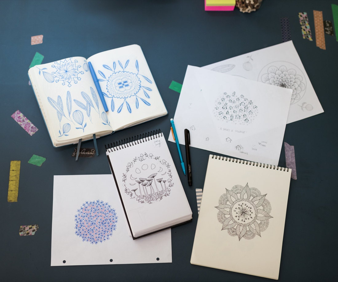 Sketchbooks showing Liz's hand-drawn embroidery pattern designs
