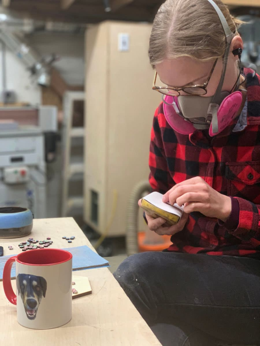 Anne at work on her jewelry designs in the AdrianMartinus woodworking studio.